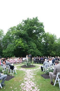such a perfect way for everyone to see+love the petals to define the aisle... would be a neat idea