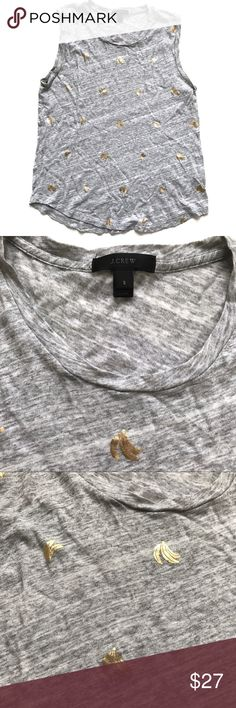"""J. Crew Metallic Banana Print Tank in Gold & Gray So quirky and unique! In great pre-owned condition. Great under a blazer for the office or to kick around in for the weekend  •Women's size S •60% Cotton, 40% Modal •18"""" across underarms, 25"""" from shoulder to hem •Item # F3314 •Retail $37.50 👋🏼 Make me an offer!  🥂 Thank you for shopping in my closet! xoxo Kate •••• J. Crew Tops Tank Tops"""