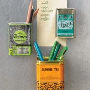Old tea containers repurposed with magnets