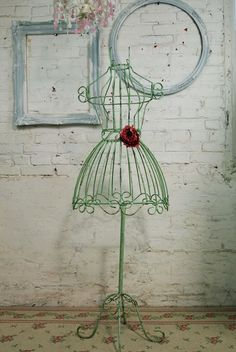 An Iron dress form in Black. This one from Etsy Shop: Painted Cottages