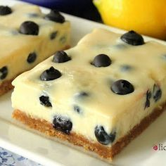 Blueberry Lemon Bars recipe from scratch ... graham cracker crust, creamy lemon filling with fresh blueberries. YUM!