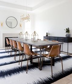My type of dining room! Love the ikat rug andhellip