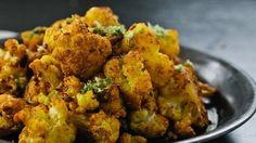 Indian-Style Cauliflower In this Indian-spiced cauliflower recipe, try your hardest not to dye everything in your kitchen yellow from turmeric.