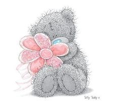 Tatty Teddy Bear holding a flower