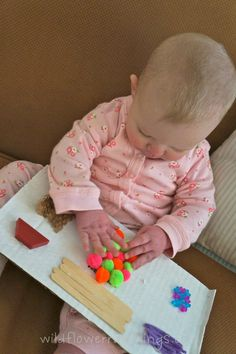 Baby sensory boards! Aria would live this! She'll definitely try to put everything on it into her mouth...lets hope that glue will really hold