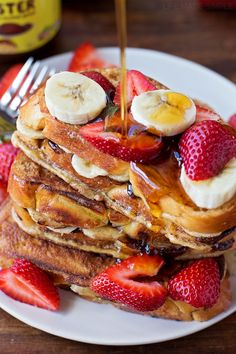 You're going to fall in love with this Chocolate Banana Stuffed French Toast! It's thick, gooey and topped with strawberries, bananas and a drizzle of maple syrup.