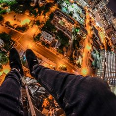 A collection of terrifying photographs, looking down from the top of skyscrapers.