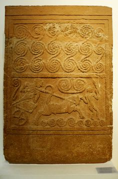 1500 BC. Mycenaean Funerary stone stele with chariot scene with spriral motifs. Mycenae, Grave Circle A, Grave V.  National Archaeological Museum, Athens.