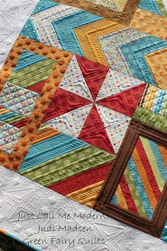 Absolutely gorgeous quilting! Love the colors too.