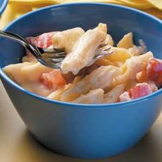 Tomato Mac 'n' Cheese Recipe    White cheddar cheese and tomatoes add a new dimension to macaroni and cheese.