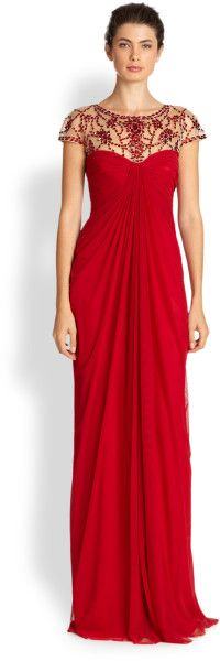 """Tadashi Shoji Red Draped Illusion Gown Make an unforgettable entrance with this festive and draped gown adorned with a face-illuminating, beaded illusion top. ;jewelneck;beaded illusion top;sweetheart bustline;cap sleeves;draped train design;back zipper;fully lined;about 45"""" from natural waist;nylon/spandex;"""