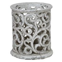 """Hurricane candleholder with open scroll detail. Product: Hurricane candleholder     Construction Material: Ceramic   Color: Cement       Dimensions: 7.5"""" H x 6.5"""" Diameter     Cleaning Instructions: Wipe clean with damp cloth"""