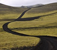 Near Lakagigar, Iceland. Photographed ByMartin Ystenes green black road hills mountain country