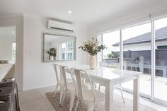 A beautiful white dining room, leading onto the large deck.  #ourstories #clientreferences #diningroom #dining #newhome #freshpaint #house #interiordesign #housedesign #generationhomesnz