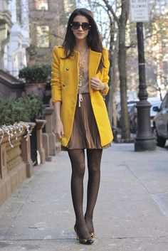 I need some pops-of-color coats. Yellow and orange are on the list! Her skirt is great too.