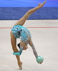 Minsk, Belarus, May 29: Liubou Charkashyna, of Belarus, performs with a ball during her final apparatus program at the 27th European Rhythmic Gymnastics Championship. Charkashyna won the first place in the competition with a ball. (AP Photo/Sergei Grits)