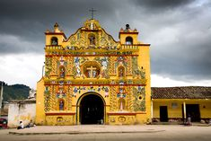 Yellow church. San Andreas Xecul, Guatemala. Tom Robinson Travel Photography: Central america.