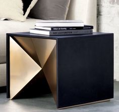 Kravitz x CB2 brass and leather end table