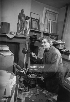English painter, war artist, occultist and joint editor of the 'Golden Hind' art quarterly, Austin Osman Spare (1886 - 1956), at his flat in Brixton, South London, 1953. Original Publication: Picture Post 6627 - Austin Osman Spare - unpub - 1953