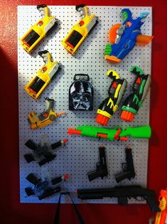 Nerf Airsoft Storage Wall  project:  Need to do this for the boys' guns!