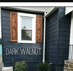 Dark blue house with walnut shutters and white window trim Wood Shutters Rustic exterior cedar shutters Shaker Exterior Paint Colors For House, Paint Colors For Home, Navy House Exterior, House Siding Colors, Blue Siding, Cabin Exterior Colors, Farmhouse Exterior Colors, Exterior Paint Ideas, Exterior Wood Stain Colors