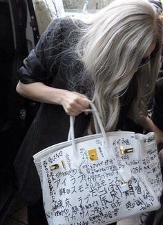 8b264a2e0ad long white hair, outsized jackie onassis style sunglasses and grafitti d grace  kelly favorite birkin bag