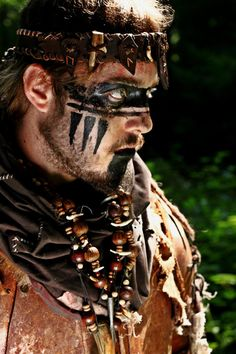 Male shaman. I love the beading and face paint!