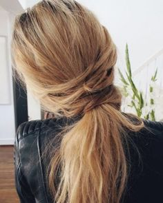 Create a chic pony-illusion by taking pieces from the front and alternately wrapping them over the hair until you get to the nape of the neck. Secure with bobby pins.