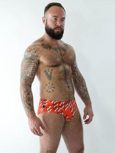 Men's red squiggle print swim brief. Lined front and has inner drawstring. Available in: S- (fits 28-30 US)M- (fits 32-33 US)L- (fits 34-36 US)XL- (fits 38-40 U