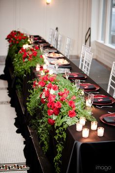 Head Table Floral Arrangement with Beautiful Draping Greenery and Red Roses.  http://www.busseysflorist.com/bridal-wedding-flowers/