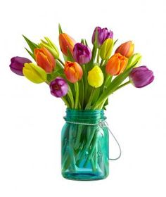 Send Mom 15 vibrant multicolored tulips, all packaged in a pretty teal-glass mason jar. To ensure the flowers last as long as possible, the tulips arrive in bud form and bloom within a few days. Once the flowers have passed their prime, repurpose the jar by turning it into a candle (tea light candle included).
