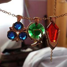 Zelda Ocarina of Time stones necklace pendants.  NEED.  WANT.  WHERE DO I BUY THEM!?!