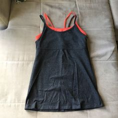 Gapfit tank size Small Grey and coral Gapfit tank with attached shelf bra. Like new condition, only worn a couple times! Size small. GAP Tops Tank Tops
