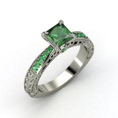 I would like something like this for an engagement ring, but most likely have the center gem be a diamond with emeralds on the side, or vise versa.