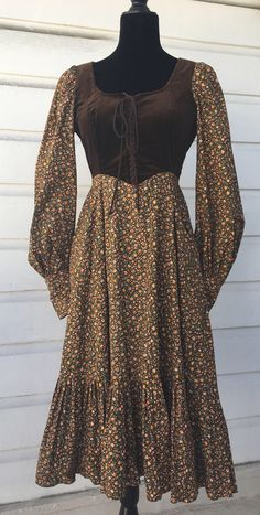 A personal favorite from my Etsy shop https://www.etsy.com/listing/518036410/beautiful-brown-velvet-bodice-midi-by-jg