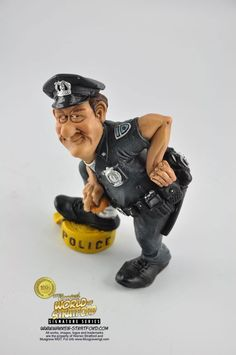 This is a Policeman collectible figurine. It is the perfect gift for Fathers Day, retirement, birthday or event. Warren Stratford http://www.warren-stratford.com/who-is-warren-stratford/  is the master of the collectible figurine.  Warren Stratford www.warren-stratford.com is the world's most loved comic artist. His collectible figurines are sold in the best retail and online shops in the world.
