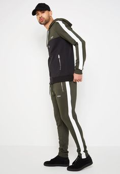 Neoprene Tracksuit Jacket with Contrast Colour Blocking and Stripe Regular Fit Stretch Fabric Silver Zips Silver Eyelets & Toggles Colour Block Design Contrast Stripe MDV Embroidery to Chest SHOP THE LOOK BELOW Model is Chest, Waist and Wears Size Medium Tracksuit Jacket, Hoodie Jacket, Track Suit Men, Gents Fashion, Mens Joggers, Colored Pants, Gym Style, Mens Activewear, Sport Wear