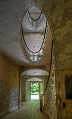 Spiral stair and entrance Dr. Oliver Bronson House in Hudson, New York. Used in the filming of the movie, Bourne Legacy, it was abandoned in the 1970's.
