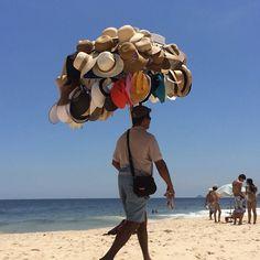Brazilian hat vendor #brazil #riodejaneiro #beach #ipanema #hat @vitalephoto