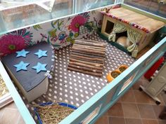 LOVE this Guinea Pig House. Especially the curtains and trim!