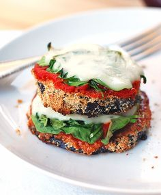These little eggplant pizzas are baked slices of breaded eggplant topped with marinara and melted cheese. Simple, healthy, delicious!