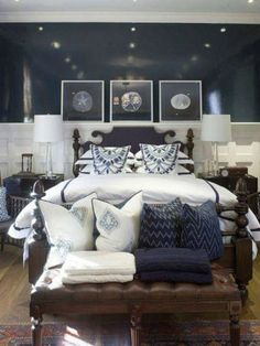 master bedroom - navy blue coastal bedroom design with glossy navy blue walls paint color, black bed, tapered glass lamps, black wood nightstands, brown leather tufted bench with nailhead trim and blue & white pillows and art! Navy Blue Bedrooms, Navy Blue Walls, Coastal Bedrooms, Master Bedrooms, Luxury Bedrooms, Teen Bedroom, Navy Master Bedroom, White Bedrooms, Upstairs Bedroom