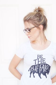 Rebel Apparel :: Be the Buffalo Women's tee in Heather White   Be the Buffalo...face your fears and run towards the storm.  #rebelapparel #rebelwear #bethebuffalo #womenswear #casualwear #travelwear #rebel #comfytee