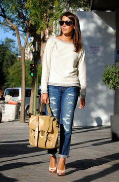 Frayed sweatshirt, ripped boyfriend jeans, and heels. <3