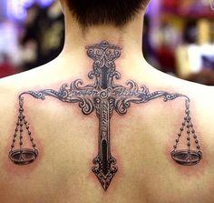 Balancing Scale Tattoo on back