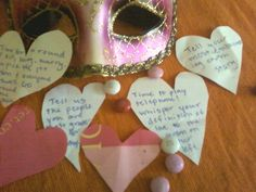 diy valentines party game idea: hearts cut from old victoria's secret shopping bag. valentine's-themed group activities on back. these were placed under each plate as a surprise after dinner #valentines party  #diy