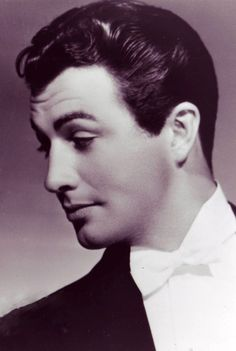 """Robert Taylor, who truly fit the title of """"matinee idol"""" from roughly 1936-45.  He is fittingly found on many """"handsomest male stars of all time"""" lists.  He was just about flawless from every angle and around 1938, one would be hard-pressed to think of a handsomer man than him."""