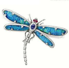 GEM-SET 'DRAGONFLY' BROOCH  designed as a dragonfly en tremblant, the wings set with four opal plaques, the body set with an oval sapphire and circular-cut diamonds, accented by ruby-set eyes