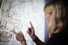 Satellite archaeologist Sarah Parcak examines an image. (Photo used with kind permission of Sarah Parcak.)