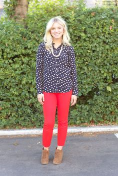 print top, red pants, booties.